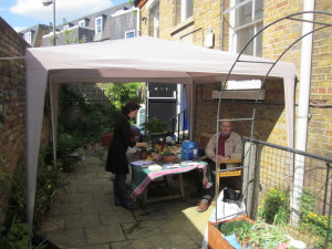 Photo of two gardeners and the gazebo in the garden